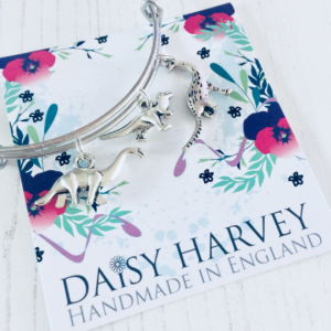 dinosaur charm bracelet by Daisy Harvey Designs